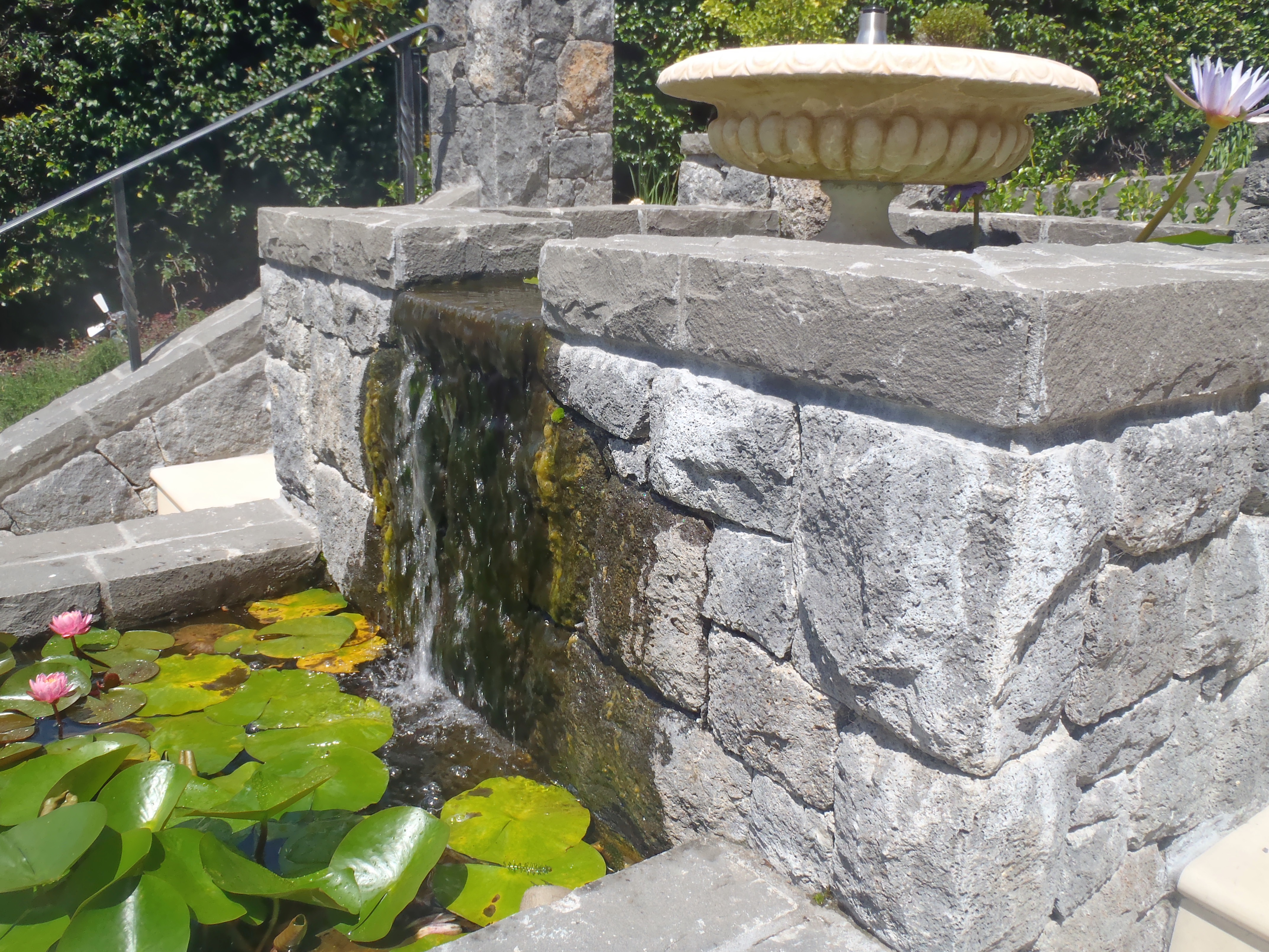 Faced stone wall and Lily Pond