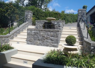 Stone Water Feature with Paved Stairs