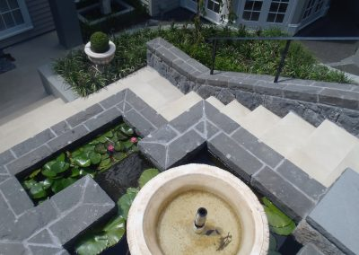 Capped Stone Wall and Paving