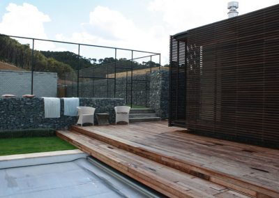 Gabion Walls define Tennis Court and Pool Area