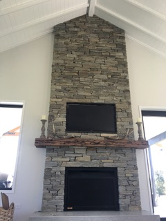 Floor to Ceiling Fireplace and Media Focus