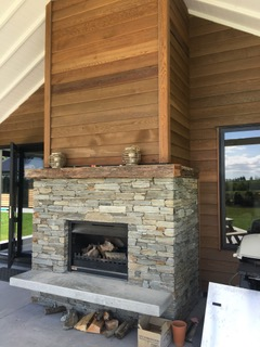 Outdoor fireplace with harth and mantelpiece