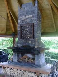 Outdoor Fireplace with Mantelpiece and Wood Storage