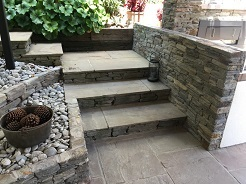 Schist wall and Pillar with stone paved stairs.