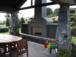 Outdoor Fireplace with Stone Pillars