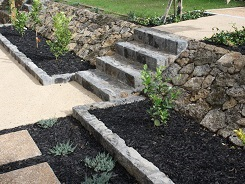 Slanted Stone Retaining wall with Steps and border