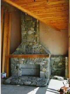 Boulder Stone Fireplace under construction