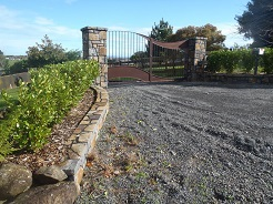 Dressed Stone Wall and Pillars Supporting Bespoke Gate